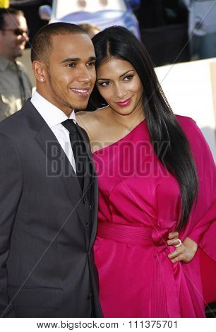 HOLLYWOOD, CALIFORNIA - Saturday June 18, 2011. Lewis Hamilton and Nicole Scherzinger at the Los Angeles premiere of