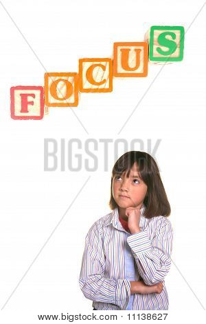 Young girl in focus posture.