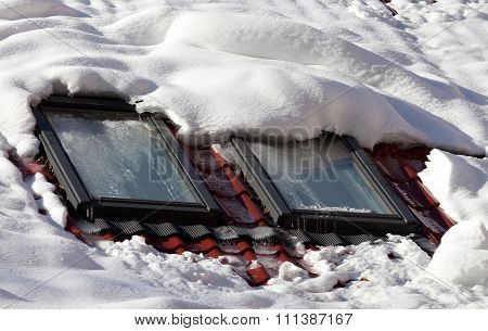 Snowy Roof With Icy Windows
