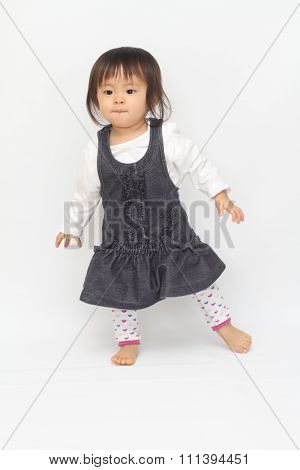 Japanese toddling girl (1 year old) in house