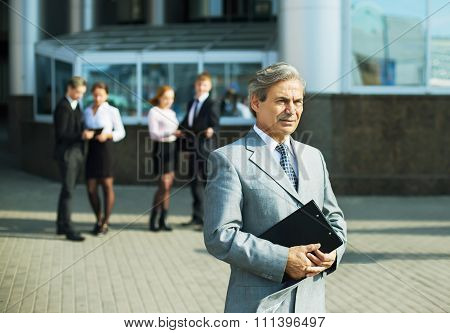 A Successful Businessman With Documents
