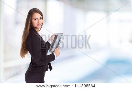 Successful Business Woman Is Studying The Contract On The Tablet.