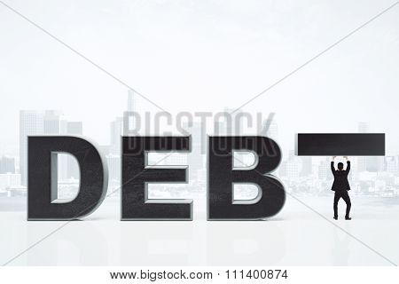 Debt Concept With Businessman And Debt Inscription At City Background