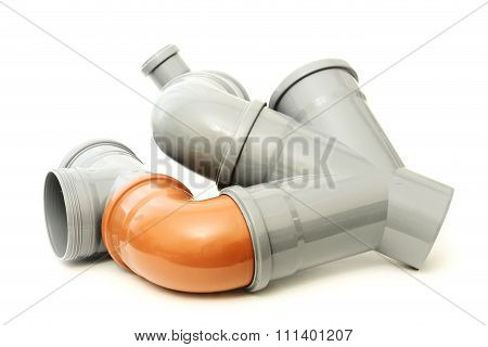 New gray and orange drain pipe isolated on white