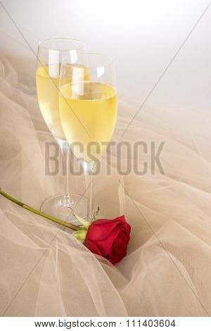 Two Glasses of Champagne with One Single Red Rose