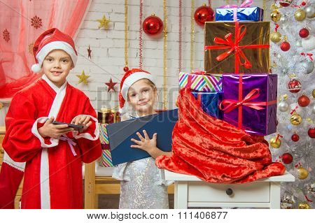 Santa Claus And Assistant Draw Up A List Of Gifts And Find Them