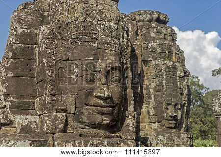Buddha's stone faces with blue sky