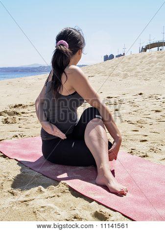 Bikram Yoga Arda Matsyendrasana Pose At Beach