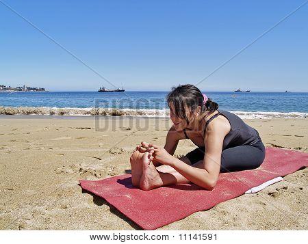 Bikram Yoga Paschimottanasana Pose At Beach
