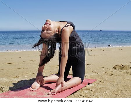 Bikram Yoga Ustrasana Pose At Beach