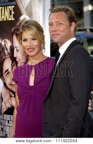 HOLLYWOOD, USA - AUGUST 23: Christina Applegate and Martyn Lenoble at the Los Angeles Premiere of