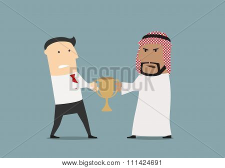 Businessmen fighting over a golden trophy cup