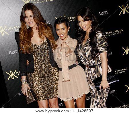 August 17, 2011. Khloe Kardashian, Kourtney Kardashian and Kim Kardashian at the Kardashian Kollection Launch Party held at the Colony, Los Angeles.