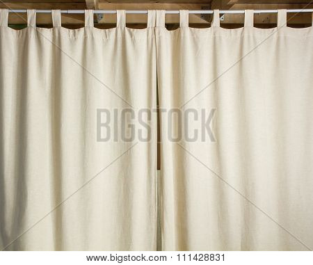 Ivory Curtain Hanging On A Metal Rod
