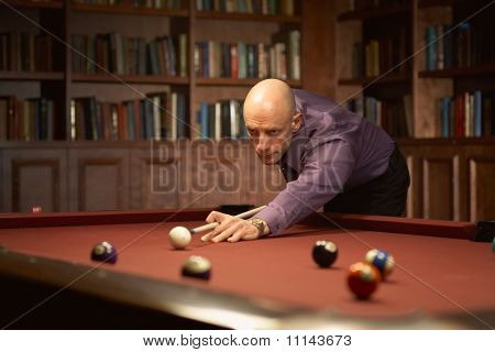 Playing pool billiards