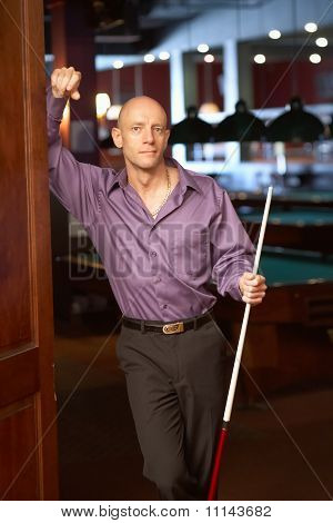 Man with pool stick billiards