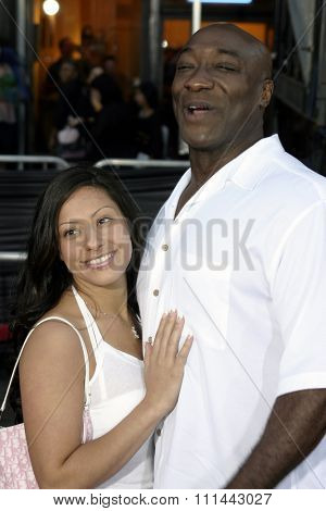 2 August 2004 - Los Angeles, California - Michael Clarke Duncan and guest. The World Premiere of 'Collateral' at the Orpheum Theatre in downtown Los Angeles.