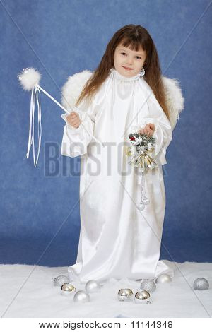 Little Girl In Suit Of Angel On A Blue Background