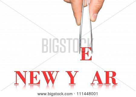 Word New Year And Hand With Tweezers