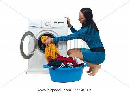 Housewife Loading Washing Machine