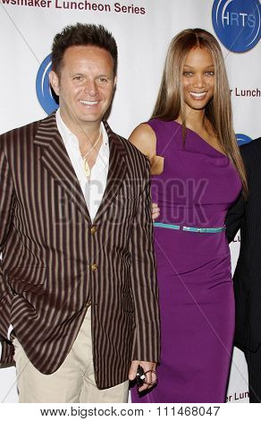 Mark Burnett and Tyra Banks at the HRTS'