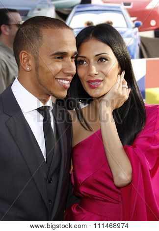 Nicole Scherzinger and Lewis Hamilton at the Los Angeles premiere of 'Cars 2' held at the El Capitan Theatre in Hollywood on June 18, 2011.