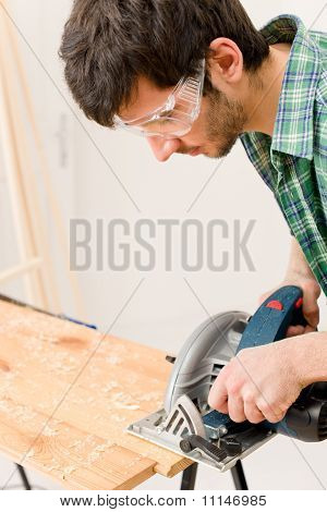 Home Improvement - Handyman Cut Wood With Jigsaw