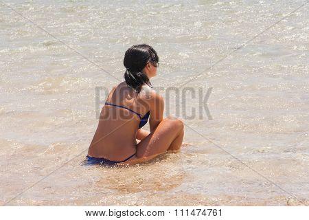 Woman Seats In The Sea.