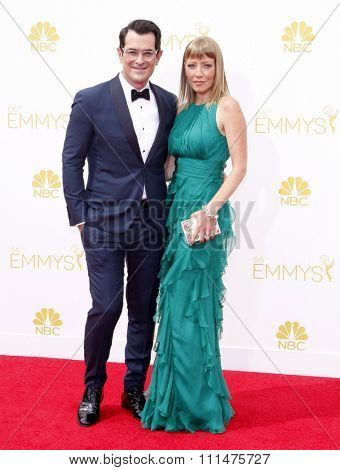 Ty Burrell and Holly Anne Brown at the 66th Annual Primetime Emmy Awards held at the Nokia Theatre L.A. Live in Los Angeles on August 25, 2014 in Los Angeles, California.