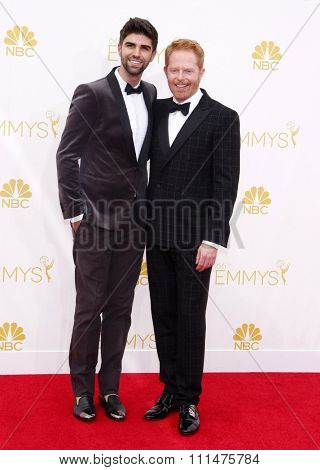 Justin Mikita and Jesse Tyler Ferguson at the 66th Annual Primetime Emmy Awards held at the Nokia Theatre L.A. Live in Los Angeles on August 25, 2014 in Los Angeles, California.