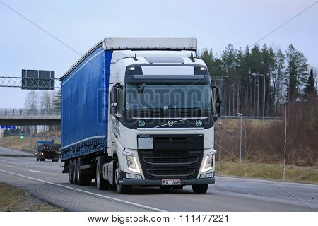 Volvo FH Semi Moving Along Highway