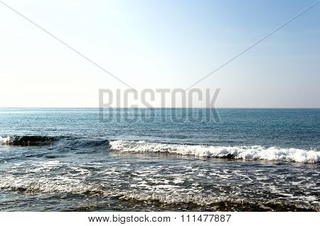 Waves Breaking On Lonely Stony Beach, Forming Sprays