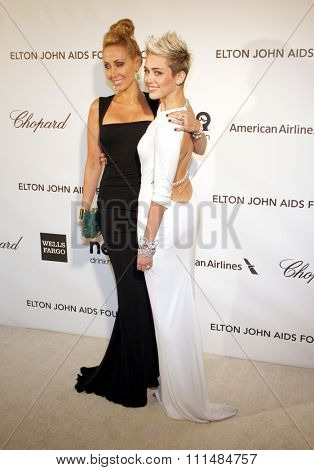 Miley Cyrus and Tish Cyrus at the 21st Annual Elton John AIDS Foundation Academy Awards Viewing Party held at the Pacific Design Center in West Hollywood on February 24, 2013.