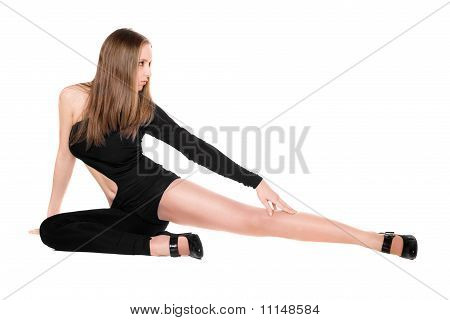 Leggy Young Woman In A Black Tight-fitting Body Suit Dance