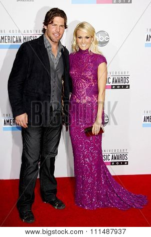 Carrie Underwood and Mike Fisher at the 40th Anniversary American Music Awards held at the Nokia Theatre L.A. Live in Los Angeles, United States, 181112.