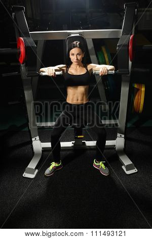 Woman trains pecs in the gym