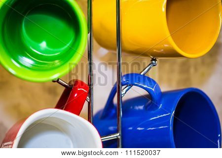 Cups And Mugs Hanging On A Holde