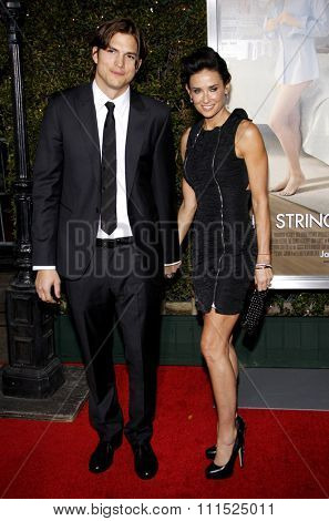 Ashton Kutcher and Demi Moore at the Los Angeles premiere of 'No Strings Attached' held at the Regency Village Theater on January 11, 2011.