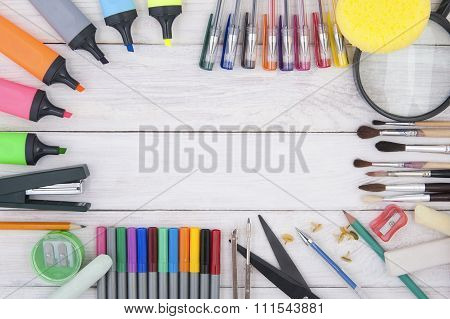 Stationery On A White Wooden Background..