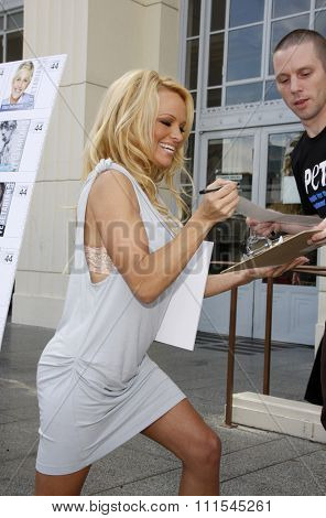 LOS ANGELES, USA - NOVEMBER 29, 2011: PETA Goes Postal: Pamela Anderson unveils Vegetarian Icons Postage Sheet held at the Hollywood Post Office in Hollywood, USA.