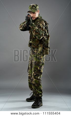Soldier In Uniform With Machine Gun