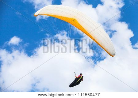 Amateur Paraglider In The Blue Sky