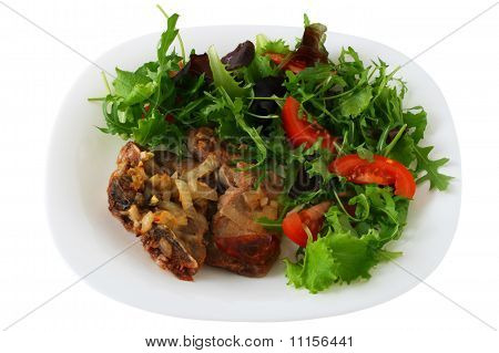 Pork with sausages and salad