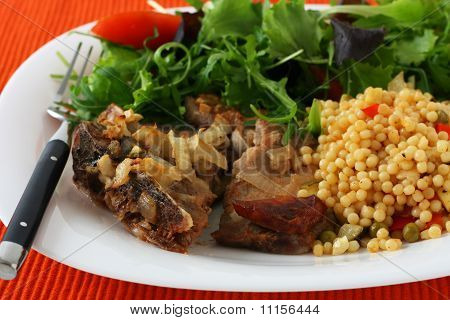 Pork with sausages and couscous