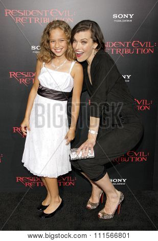 Milla Jovovich and Aryana Engineer at the Los Angeles premiere of 'Resident Evil: Retribution' held at the Regal Cinemas L.A. Live in Los Angeles, USA on September 12, 2012.
