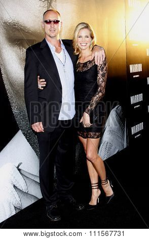 HOLLYWOOD, CA - SEPTEMBER 06, 2011: Gavin O'Connor and Brooke Burns at the Los Angeles premiere of 'Warrior' held at the ArcLight Cinemas in Hollywood, USA on September 6, 2011.