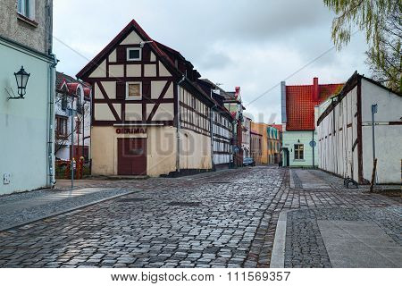 Narrow street with half-timbered residential houses. Market street. Old town of Klaipeda city