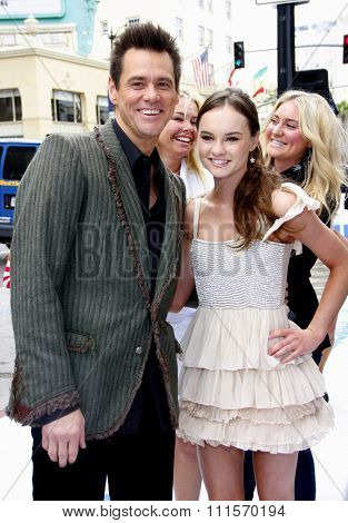 HOLLYWOOD, CA - JUNE 12, 2011: Jim Carrey and Madeline Carroll at the Los Angeles premiere of 'Mr. Popper's Penguins' held at the Grauman's Chinese Theatre in Hollywood, USA on June 12, 2011.