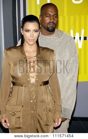 LOS ANGELES, CA - AUGUST 30, 2015: Kanye West and Kim Kardashian at the 2015 MTV Video Music Awards held at the Microsoft Theater in Los Angeles, USA on August 30, 2015.