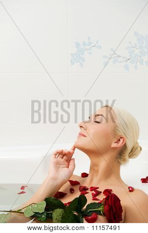 Lovely young woman relaxing in a bathroom